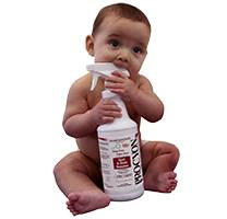 Baby chewing on safe cleaning product